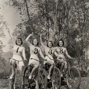 Carole Parker, Joyce Mathews, Lola Jensen and Alma Ross ride bikes, and wave goodbye to 1938 – and to 2014 while they're at it. Happy New Year from Rides a Bike!