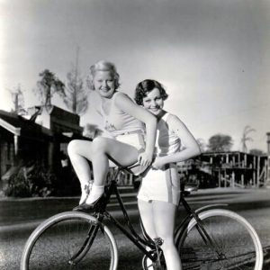 Muriel Evans gives Mary Carlisle a ride.