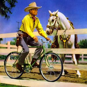 Buck Jones rides a bike.