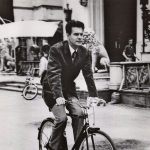 Louis Jourdan rides a bike.