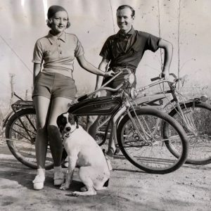 Evelyn Knapp and Earl Blackwell rest bikes. Actor and Actress Go Cycling…. Evelyn Knapp and Earl Blackwell of the films pausing on cycling expedition into the Hollywood hills to give Miss Knapp's pointer a rest. The actress is wearing the latest costume for fall bicycle riding: a wool jersey and flannel shorts. Acme Photo.