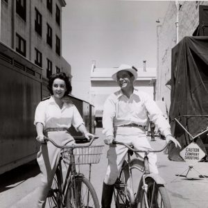 Elizabeth Taylor and Dana Andrews ride bikes.