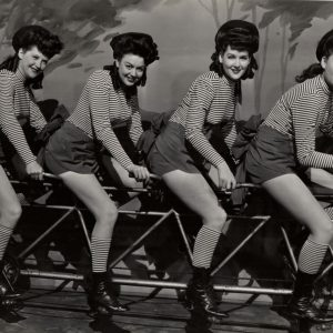 """Sweet Rosie O'Grady"" chorus girls ride a bike."
