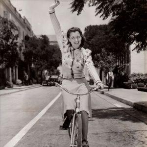 Ellen Drew rides a bike.