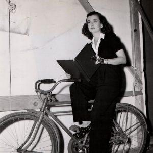 Joan Bennet rides a bike, runs her lines.