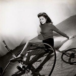 Helen Pender falls off a high wheel bike.