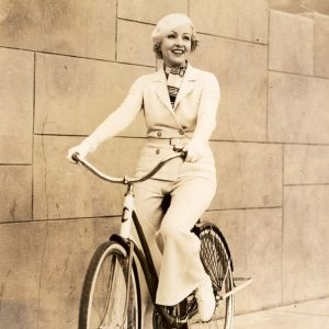 Claire Windsor rides a bike.
