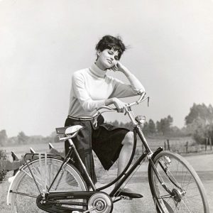 Claudia Cardinale models a bike.