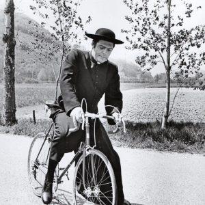 Marcello Mastroianni rides a bike, religiously.