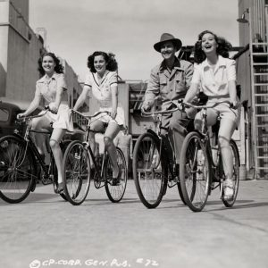 Shirley Patterson, Alma Carroll, John Hubbard and Adele Mara ride bikes.