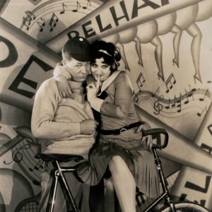 Jack Oakie and Helen Kane get cozy on a bike.