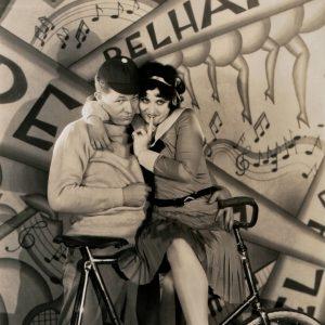 Jack Oakie and Helen Kane get cozy on a bike.
