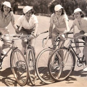 "Kathleen Burke, Grace Bradley, Lona Andre and Mari Colman ride bikes, with mallets.""POLO-A-LA-MODE….Hollywood is indulging in a new form of the old game. Bicycle polo has been inaugurated by this team consisting of Kathleen Burke, Grace Bradley, Lona Andre and and Mari Colman at the Paramount Studios."" – May 18, 1933"