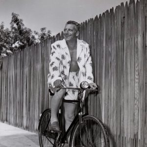 Ezio Pinza rides a bike, in his summer togs.