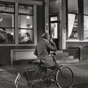 """Jean"" rides a bike, shops for company. From""The Woman In the Window"" (""La ragazza in vetrina"") with Marina Vlady, Lino Ventura, MagaliNoël."
