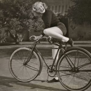 June Haver mounts a bike.