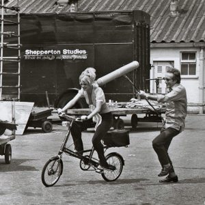 Goldie Hawn rides a bike, Peter Sellers rides a boom mike.