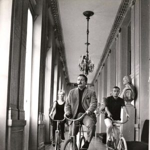 Paule Noelle, Jacques Fabbri and Jean Paul Roussillon ride bikes, chez Molière.