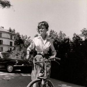 Irina Demick rides a bike.