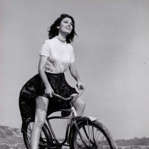 Paula Prentiss rides a bike, billowingly.