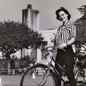Natalie Wood rides a bike, stripedly.