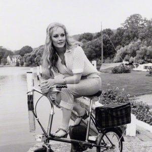 Jenny Hanley rests a bike, river-side.