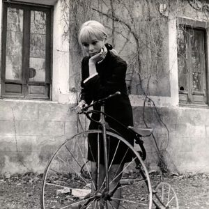 Geraldine Chaplin contemplates a bike.