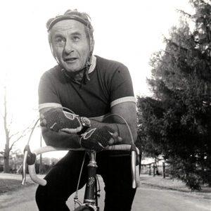 Eli Wallach rides a bike.