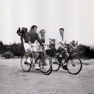 Dean Martin, Janet Leigh and Jerry Lewis ride bikes. Apple Valley Inn, 1954.