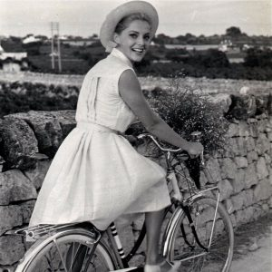 Virna Lisi rides a bike.