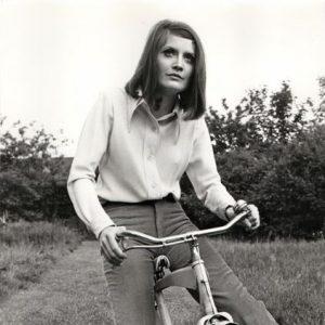 Sandie Shaw rides a bike.