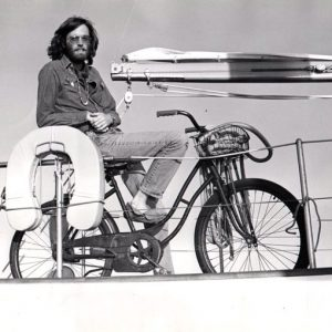Peter Fonda rides a bike, on a boat.