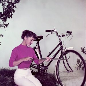 Debbie Reynolds pumps a bike.