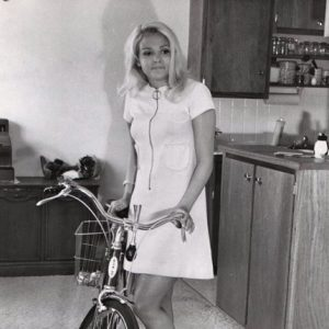 Joyce Jillson gets ready to ride – in the kitchen.