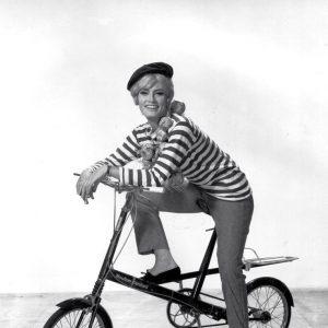Marisa Mell rides a bike – a Moulton.