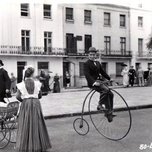 Cantinflas rides a bike.