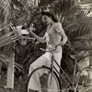 Linda Darnell rides a bike, collects the mail.