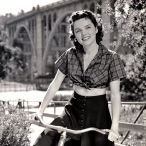 Jane Wyatt rides a bike.