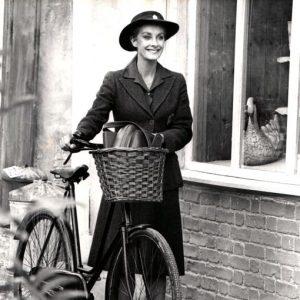 Jean Marsh walks a bike.