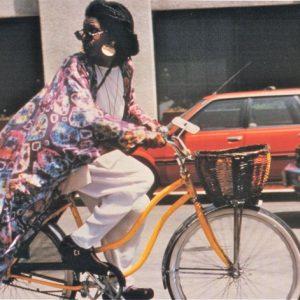 Whoopi Goldberg rides a bike.