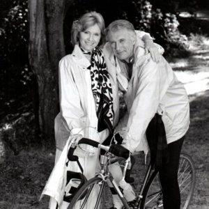 Richard Kiley rides a bike, Eva Marie Saint lends support.