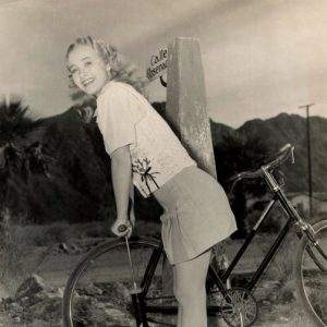Jane Powell pumps a bike tire.
