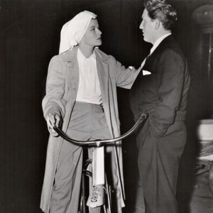 Katharine Hepburn rides a Grip Dept. bike, Spencer Tracy discusses.