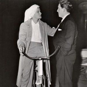 Katharine Hepburn rides a Grip Dept. bike, Spencer Tracy discusses.