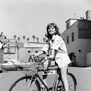"Mariana Hill rides ""Bird"" Clarke's bike."