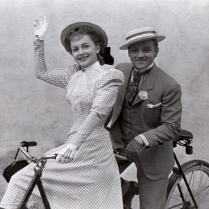 Olivia de Havilland and James Cagney ride a bike. Happy 100th Ms. de Havilland!!
