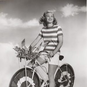 Joan Caulfield rides a bike, patriotically. Happy 4th from Rides a Bike!