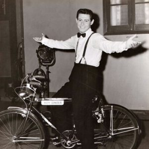"Eddie Fisher rides his ""Boy Singer"" bike."