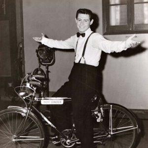 """Eddie Fisher rides his""""Boy Singer"""" bike."""