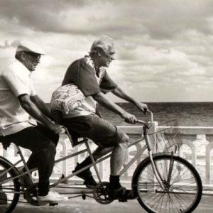 Robert Duvall and Richard Harris ride a bike.